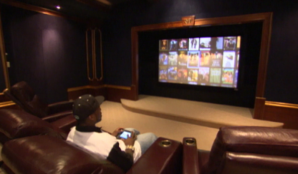 In his movie theater, Curtis has over 3000 movies available at the touch of a button.
